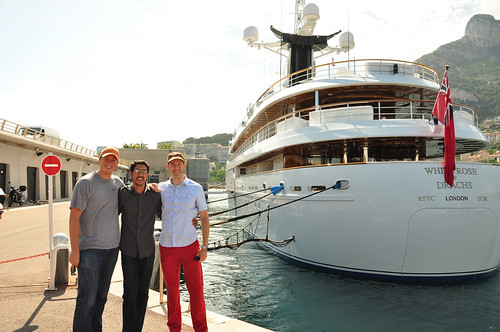 The University of Texas team, from left to right, Ken Pesyna, Jahshan Bhatti, and Professor Todd Humphreys, pose behind the White Rose docked in Port de Cap d'Ail.