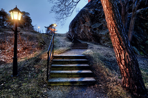 trees light mountain nature lamp grass stone stairs landscape shadows sweden dusk branches hill steps bark sverige railings leaning hdr gravel nynäshamn