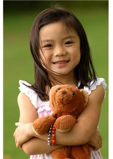 4 year old girl holding teddy bear