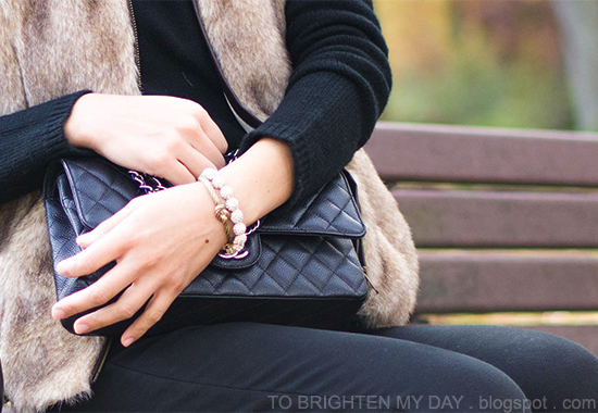 fur vest, quilted bag, bracelets