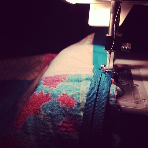 Sewing on binding while watching Charlie Brown. Perfect.