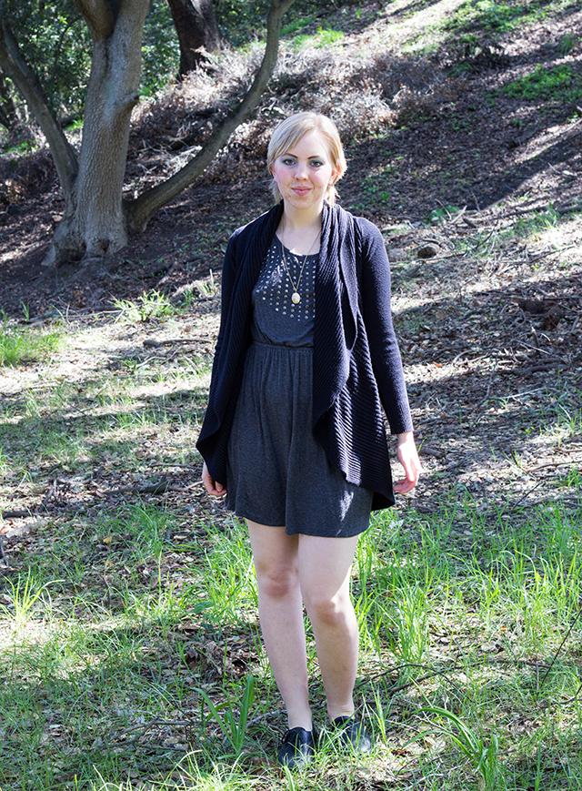 blonde pixie cut, draped cardigan, embellished grey dress