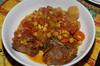 Neck of lamb casserole with tomatoes and chickpeas