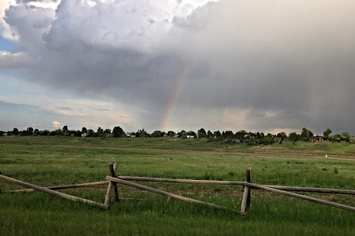 sky cloud rainbow rain cloudy storm wooden fence colorado front range fortcollins mountain an co
