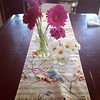 My Mother's Day flowers, and cool runner I picked up today at Philly's Art Star Market.  And, uh, my horribly scratched up table.  Whatevs.  Better for art projects.  :)