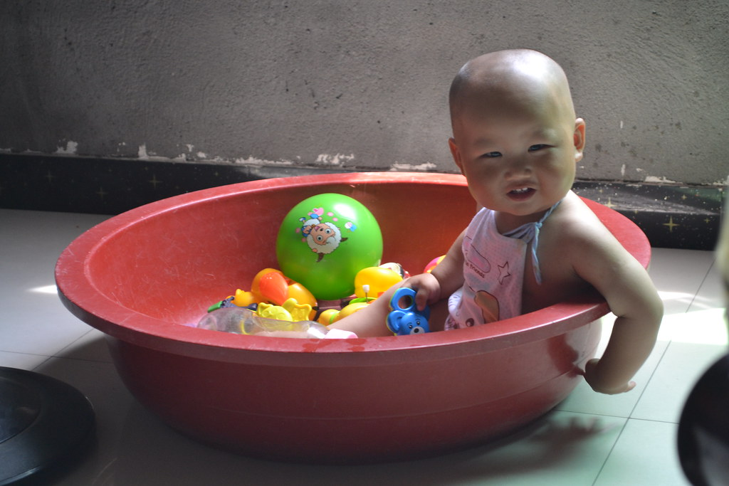 Picture of a baby in bathtub full of toys from REAP's parenting program in rural China