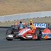 E.J. Viso and JR Hildebrand race up the hill into Turn 2 at Sonoma