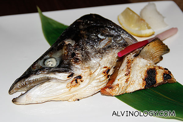 Separate order of grilled salmon fish head for sharing