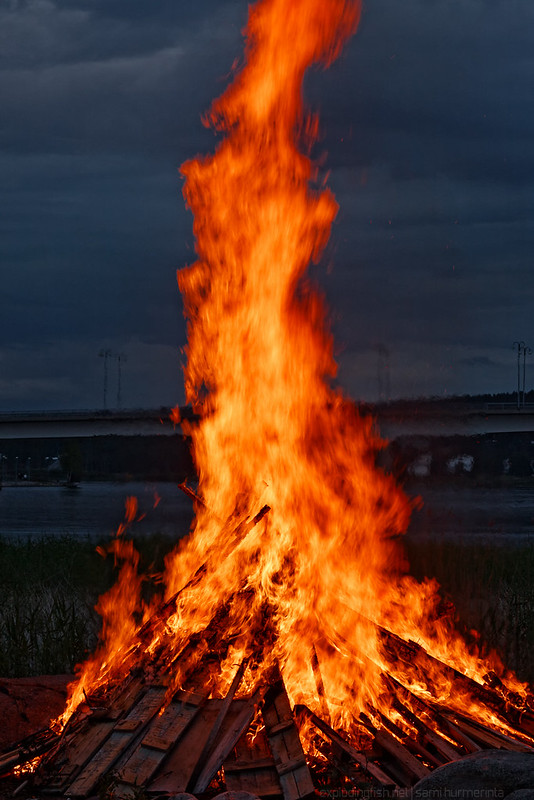 People looking at a midsummer bonfire