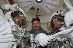 STS-125 Crew Members Pose for a Photo in the Airlock Prior to EVA3