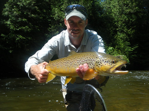 "Graham with a 23.5"" brown trout"