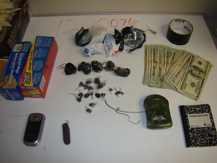 seized black tar heroin and cash