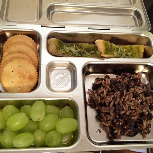 Reno's Lunch: Her Nonna's Rice and Beans, leftover mini pesto and #vegan cheese pizza, grapes, crackers. #planetbox