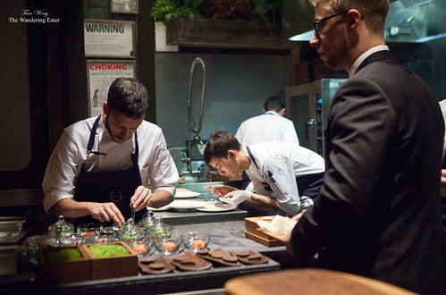 Chefs plating in the kitchen