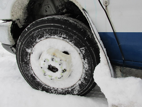 Front bus wheels caked in snow.  Wheeling Illinois. Thursday morning, January 2nd, 2014. by Eddie from Chicago