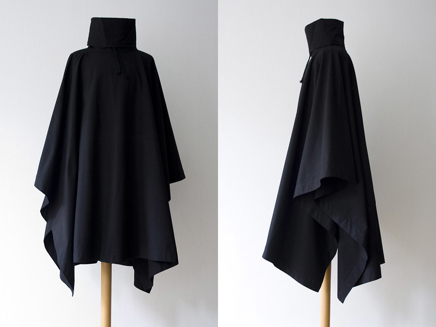 Raf Simons Autumn- Winter 1998-1999  We are offering this stunning cape by Raf Simons, done in a stiff high quality cotton, deep black. 3