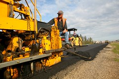 Road crew paving highway in Alberta
