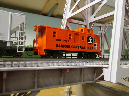 A Centralia Car Shops H.O Scale model of a 1970's era Illinois Central Gulf Railroad orange side door caboose. by Eddie from Chicago