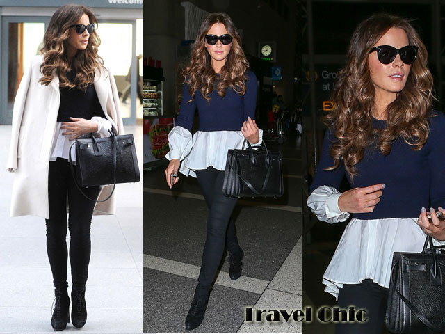 travel-chic,peplum top and a blue jumper,  white peplum top teamed with blue jumper, peplum top teamed with a jumper, ways of styling a peplum top, cropped jumper, black skinny jeans, coat over the shoulder, cream overcoat