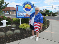 Theresa Irene Wolowski waving hello from the Welcome to the City of Long Beach sign on LBI Long Beach Island, New York, USA