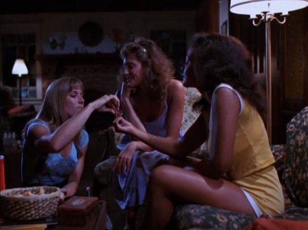 A bunch of girls sit on a bed in Slumber Party Massacre