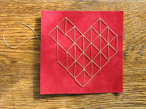 Stitched heart on velvet paper