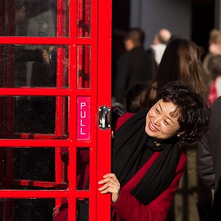 London tourist and red phonebox, Covent Garden