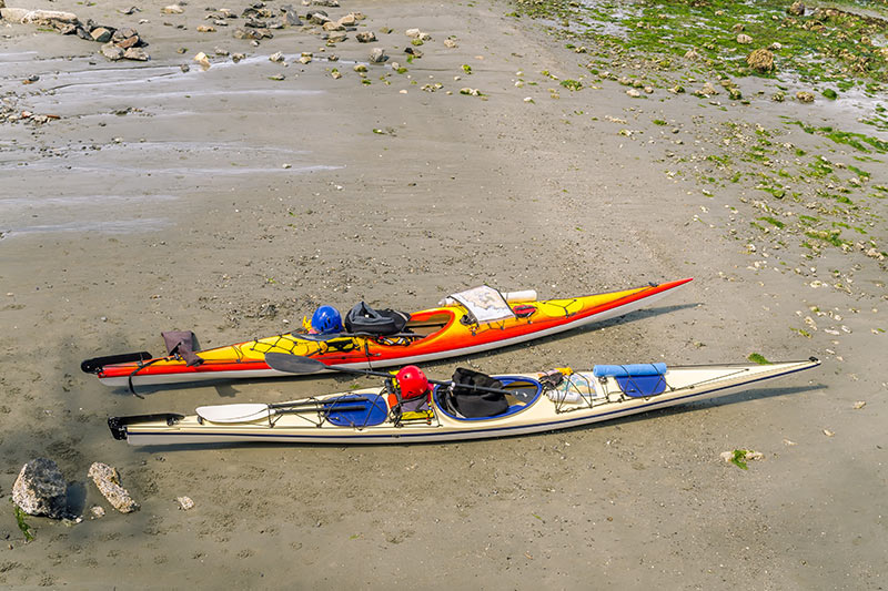 Sea Kayaks ashore in British Columbia, Canada.
