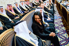 Former U.S. Secretary of State Condoleezza Rice chats with a member of the Saudi Royal Family after welcoming the new King Salman of Saudi Arabia at the Erqa Royal Palace in Riyadh, Saudi Arabia, on January 27, 2015, and after joining President Obama, First Lady Michelle Obama, U.S. Secretary of State John Kerry, and other dignitaries in extending condolences to the late King Abdullah. [State Department photo/ Public Domain]