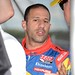 Tony Kanaan talks with his team in the pit box at Pocono Raceway