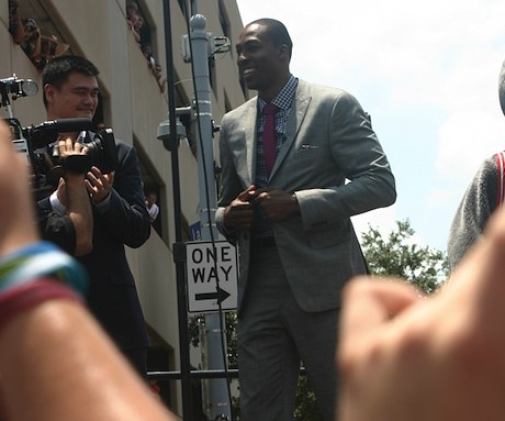 July 13, 2013 - Yao stands behind Dwight Howard outside Toyota Center at his welcome rally