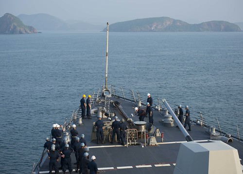 Sailors drop the anchor prior to the guided-missile destroyer USS Mustin (DDG 89) arriving for a port visit in Pattaya