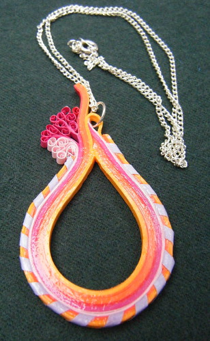Quilling strip pendant with 'bandaged' border by Philippa Reid
