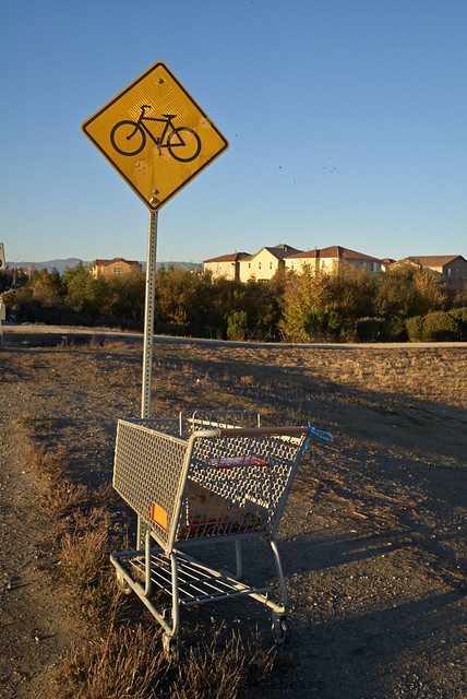 not sure why a bicycle is on a yellow diamond caution sign.