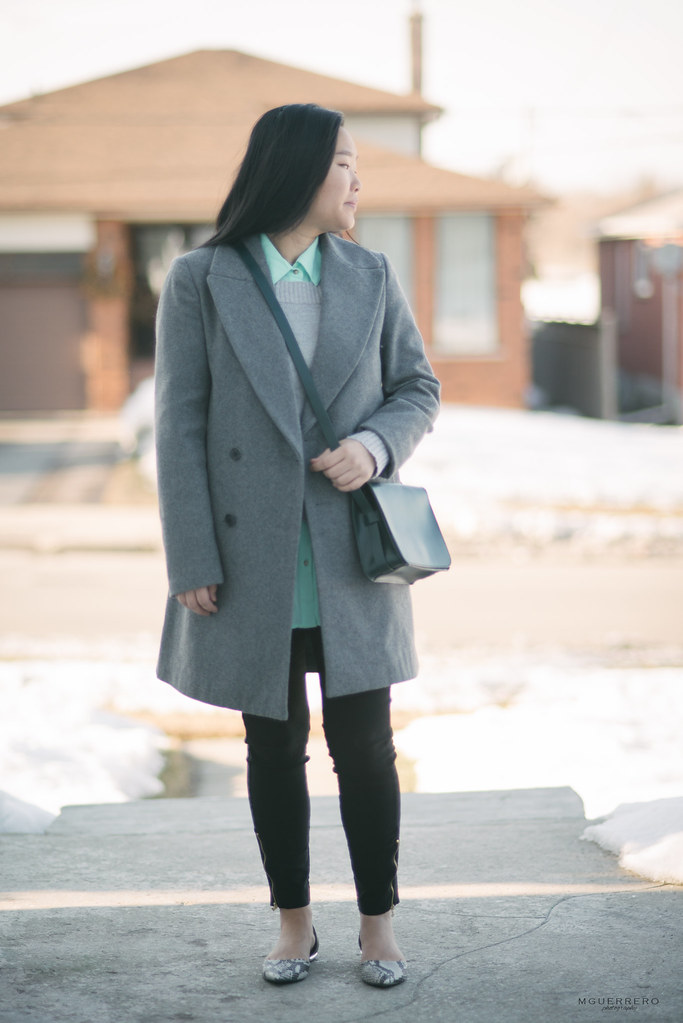 gray coat and pop of mint