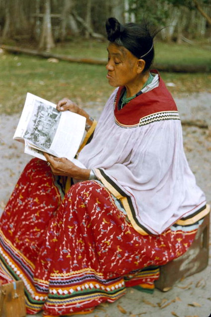 Seminole woman reading at Big Cypress Reservaton from Flickr via Wylio