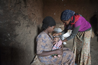 Breast Feeding-Tena Esubalew Health Extension Worker coaches Etenesh Belay positioning of the child for effective breast feeding
