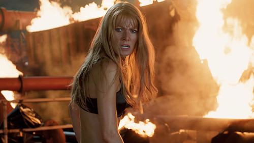 Pepper Potts, in a bra surrounded by fire