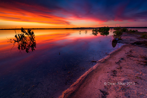 park pink red sky orange lake reflection nature water beauty crimson clouds rural sunrise landscape dawn twilight pond rocks texas unitedstates outdoor horizon scenic dramatic vivid nobody manmade bushes fortworth benbrook urbanlake bodyofwater nonurbanscene