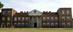 stately home(0.0), synagogue(0.0), school(0.0), palace(0.0), residential area(0.0), classical architecture(1.0), building(1.0), property(1.0), architecture(1.0), manor house(1.0), estate(1.0), mansion(1.0), facade(1.0), home(1.0),