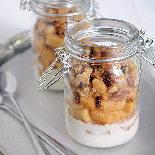 Apple crisp with maple whipped cream and spiced apple in a jar