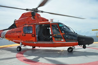 A Coast Guard Air Station New Orleans  MH-65 helicopter aircrew on an oil platform in the Gulf of Mexico prepares to medevac a man 60 miles south of Terrebonne Bay,  Sept. 18, 2013. The man was then taken to West Jefferson Medical Center. (U.S. Coast Guard photo)