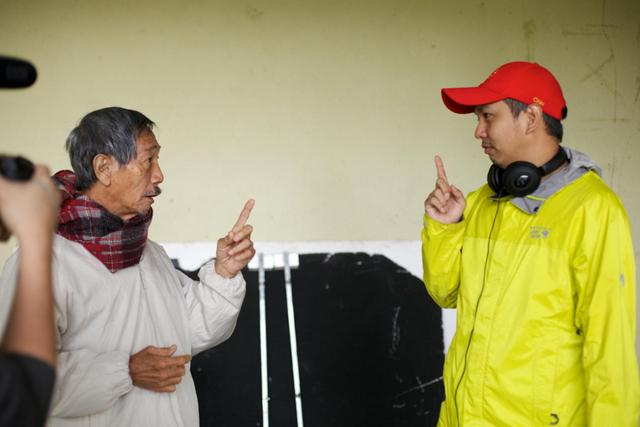 Director Chiu interacting with Frankie Lee on the set of The Journey