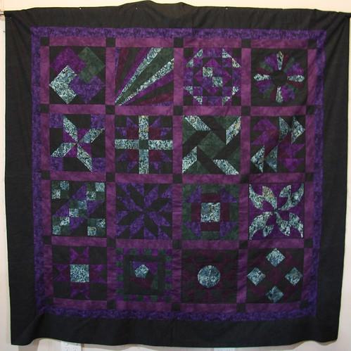 completed sampler quilt top