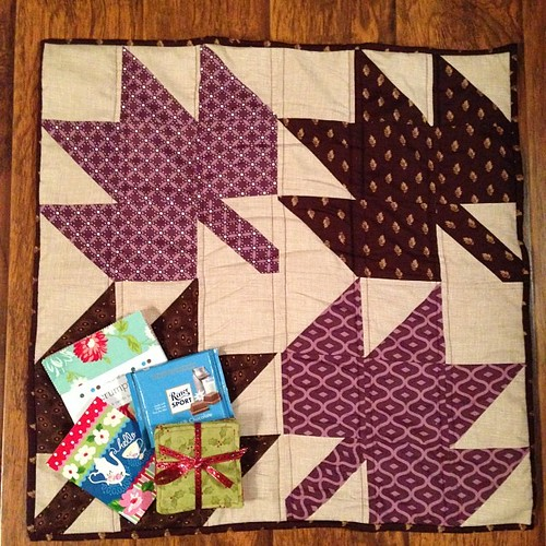 @laurel_langworthy I love my quilt and goodies!! Purple, kitties, chocolate... Perfect!! Thanks! #schnitzelandboominiquiltswap