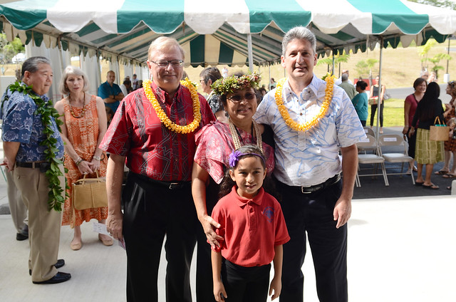 <p>Keiki Kawai'ae'a, the director of the UH Hilo Ka Haka 'Ula O Ke'elikōlani College of Hawaiian Language with her grand daughter Hāweoʻulakaumaka Mākaʻimoku (center), UH Hilo Chancellor Donald Straney (left) and UH System Interim President David Lassner (right) at grand opening of the college's new home, Haleʻōlelo.</p>