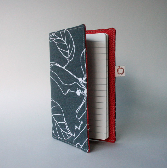 Covered notebook with red pockets