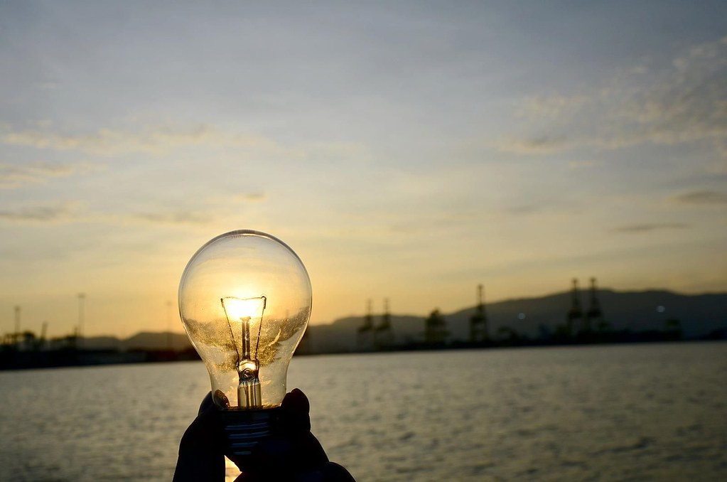 Sustainability image light bulb at sunset
