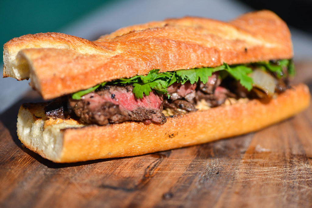 Grilled Jalapeño-Marinated Steak Sandwiches With Charred Onions and Cotija Mayo