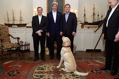 U.S. Secretary of State John Kerry -- accompanied by his 'DiploMutt' Ben -- stands with Mexican Foreign Minister José Antonio Meade, left, and Canadian Foreign Minister John Baird, right, inside his home in Boston, Massachusetts, on January 30, 2015, before an informal working dinner focused on trilateral issues. [State Department photo/ Public Domain]